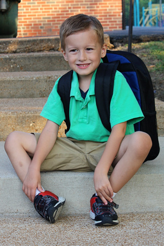 Nathan-on-stairs-of-school