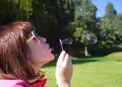 Blowing bubbles (CardiganKate) Tags: pink blue trees sky green grass sunglasses sussex bubbles blowing blow 1855mm ashdownpark lissyloola erinisfunky pentaxkr wwwkatebenjamincom