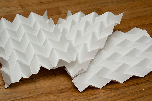 Pleated folded paper