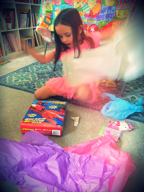 Ella's birthday gift unwrapping face