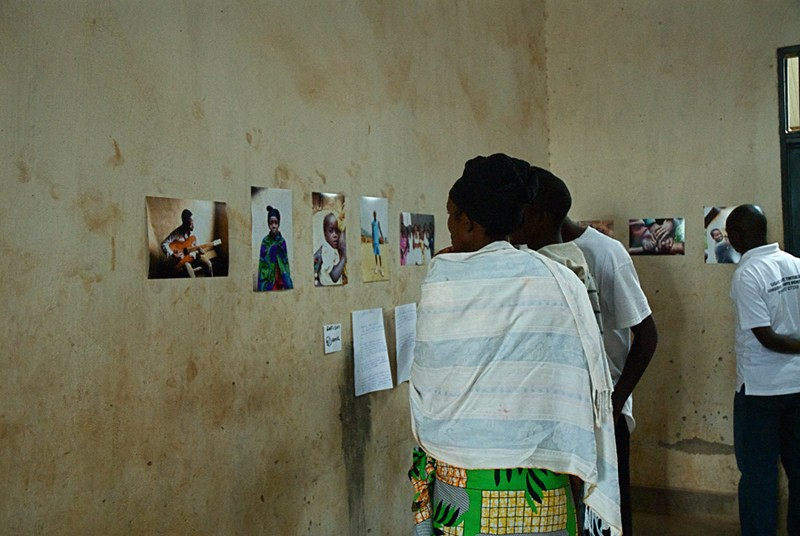 Gafishi Daniel's Mother Looks At A Portrait Of Herself In The Photography Exhibition at Kiziba Refugee Camp