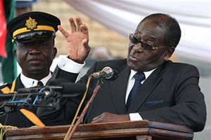 Republic of Zimbabwe President Robert Mugabe speaks from the lectern inside the country. Mugabe urged historians to narrate the true history of Africa. by Pan-African News Wire File Photos