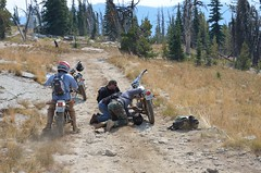 Bike repairs as we start the descent from Burnt Knob Photo