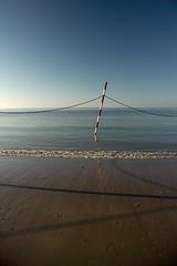 Calmness (martinstelbrink) Tags: shadow beach germany northsea nordsee redandwhite baltrum ebbtide a700 zeiss1680mmf3545 bathingboundary