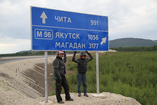 Kirill Ivoutin and John Dunn stand beneath the sign that reads Chita, Vladivostok, Magadan. Johns only piece of proof of the closest he got to Madagan