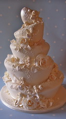 Wonky Rococo wedding cake (nice icing) Tags: wedding roses cake hearts gold carlton towers cream pearls cherub icing madhatter