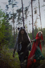 The Rush (Alexander Kuzmin) Tags: wood red wild portrait haircut green girl fashion fairytale forest hair scary couple wolf alone dress darkness availablelight innocent riding short stare hood cloak gaze glance redridinghood alexanderkuzmin kuzmin