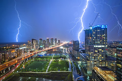 Zeus Storm from the 32nd floor (dave~) Tags: city sky urban toronto ontario canada storm night nikon highway long exposure cityscape strike lightning gardiner condos nikkor streaks thunder hdr d3 cityplace 14mm