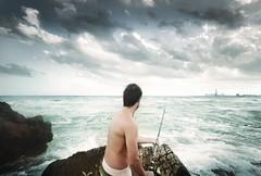 (Luis Hernandez - D2k6.es) Tags: barcelona boy sea portrait sky cloud fish beach water canon atardecer mar mediterraneo retrato peces bcn playa nubes nublado pesca caa badalona montgat ocata
