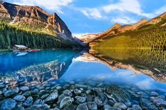 Lake Louise On The Rocks (nailbender) Tags: lake canada mountains water sunrise landscape rocks canoe banff lakelouise boathouse nailbender
