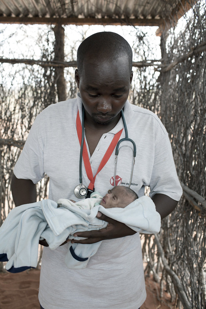 Umi, three months old, is examined by Daniel Wanyoike, the Community Therapeutic Nurse at a Save the Children outreach site in Kenya