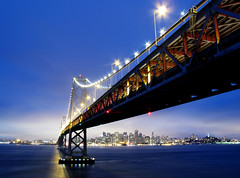 Brilliance (jirfy) Tags: city bridge blue sunset urban tower skyline night island oakland bay twilight san francisco downtown pyramid hour glowing transamerica yerba coit ybi buena bustling