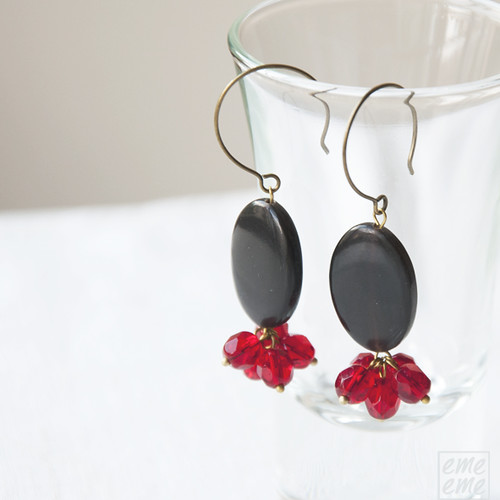 Earrings Oval black horn and faceted red  glass beads