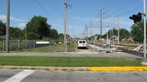 Community service work on the CTA yellow line. Skokie Illinois USA.  August 2011. by Eddie from Chicago