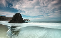 Earth, Sea, Sky (Tony Immoos) Tags: california longexposure morning sky motion reflection clouds landscape coast sand surf pacific postcard scenic wideangle landmark explore marincounty f22 e3 seashore daytrip rodeobeach cokin thearchives californialandscape zd nd8 ndgrad zuikodigital p121f olympuse3 918mm
