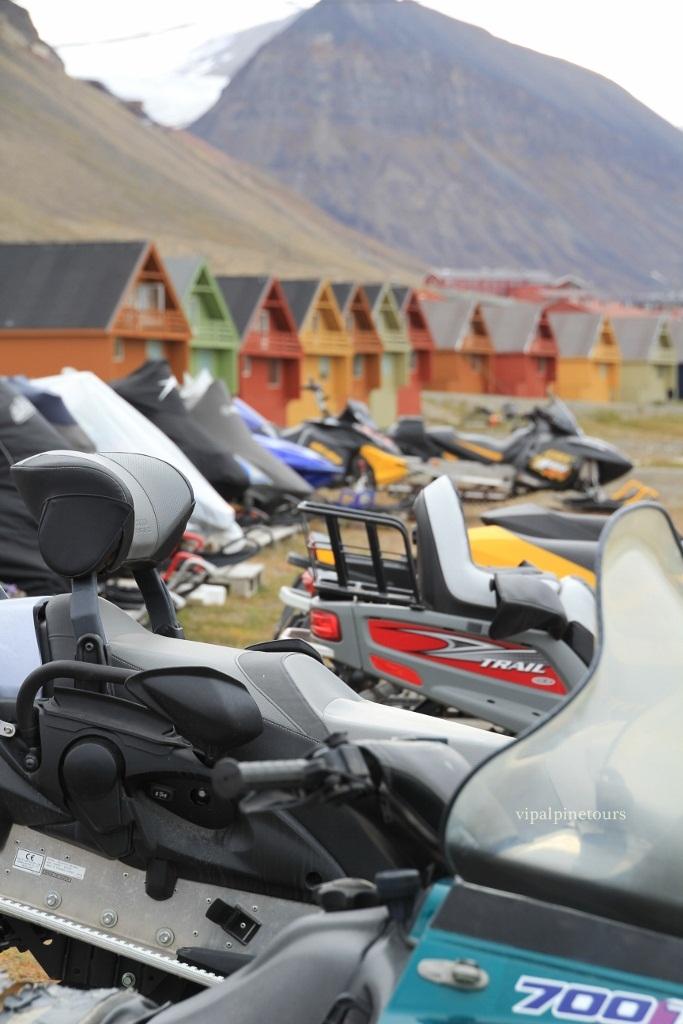 Snowmobiles waiting on winter, Longyearbyen Svalbard