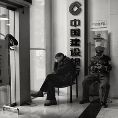Who's guarding the bank ? (Rob-Shanghai) Tags: china people blackandwhite bw asia shanghai bank  guards m43 gf1
