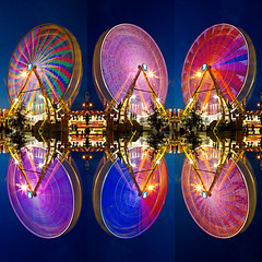 Ferris Wheels [Explored] (gtsomething) Tags: longexposure canada color colour wheel lights colorful edmonton wheels alberta ferriswheel lighttrails colourful ferriswheels klondikedays capitalex gtsomething