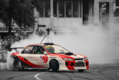 Smokescreen (Raoul Automotive Photography) Tags: camera city red white black holland netherlands wheel skyline bavaria star rotterdam nissan stripes smoke sony tripod wide band nederland screen rubber racing filter r series mm nl 1855 gt alpha dslr 50 rim rims hama dt circular tyre drifting drift 61 gtr pl smokescreen 55200 kenko a230 2011 polarisation a230l