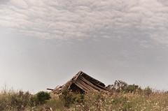 structure no trees (mattcameasarat) Tags: sky santacruz house abandoned film 35mm space sunny negativespace hut destroyed rubble ucsc feild