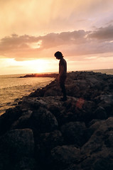 (Kyle Shields) Tags: ocean light sunset sky sun storm color reflection film beach wet water rain weather rock clouds standing 35mm dark mexico person stand rocks waves alone glare gulf minolta emotion vibrant ripple background watching wave alf scene stare lonely rough 135 splash staring 35 distant