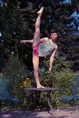 Jordan, circus artist at Ecole Nationale de Cirque in Montreal, Quebec. (the violet fox) Tags: portrait garden table chair circus whimsical