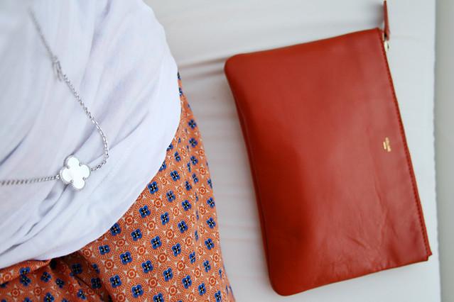 van cleef and arpels, celine clutch, zara pants, orange look