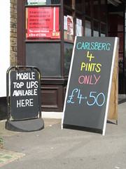 Walmer - mobile top ups available here (Dubris) Tags: england sign kent deal pint carlsberg walmer topup offlicence