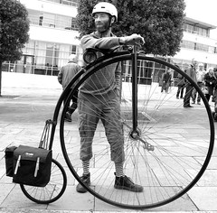 thoroughly modern penny farthing (jackeeadio) Tags: man bicycle beard glasses candid helmet belfast northernireland pennyfarthing irleand ulster panniers saddlebag stripedsocks onyourbike cylist qft queensfilmtheatre