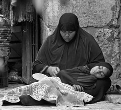 A Madona and a Child (ybiberman) Tags: portrait bw woman israel child jerusalem hijab oldcity begger mercy alquds