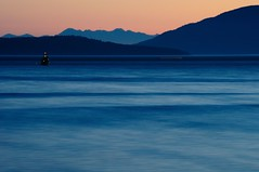 evening on the water (ChezChiens) Tags: ocean blue trees light sunset orange motion mountains water evening boat hills pugetso