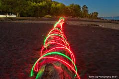 Spanish_Banks_log_light_painting_2056_WATERMARKED2_small (kevineng9) Tags: light red green beach colors vancouver painting log colorful bc spanish glowing lit colourful banks