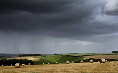 Rain over the Wiltshire Downs (Humphrey Hippo) Tags: uk england sky field rain clouds landscape gb wiltshire haybails broadchalke canonefs1855mmf3556is