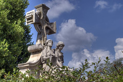 Oakland Cemetery: Mother and Daughter memorial (StGrundy) Tags: city atlanta sky sculpture friedhof usa cemetery graveyard statue architecture clouds georgia nikon memorial unitedstates cementerio historic southern cemitrio hdr celticcross neoclassical upward motheranddaughter cimetire oaklandcemetery fultoncounty 3xp nationalregisterofhistoricplaces photomatix cimiteri tonemapped d80 backyardshots stgrundy nealfamilymonument