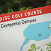 Sign at the start of the Centennial Campus nine hole disc golf course.