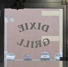 IT'S RAININ' DOWN AT THE DIXIE GRILL (NC Cigany) Tags: door cars window rain sign downtown bricks thesouth 0506 dixiegrill wilminngtonnc reverseonglass