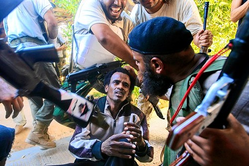 US-NATO supported counter-revolutionary rebels hold Libyan patriot at gunpoint during their imperialist-backed siege of the country during late August 2011. The Pentagon and NATO have terrorized the North African state since February.  by Pan-African News Wire File Photos