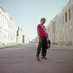 (patrickjoust) Tags: street city red portrait people urban usa house color 120 6x6 tlr film home girl smile shirt analog america pose square lens person us reflex kid md focus fuji mechanical united north middleeast patrick twin maryland row baltimore east mat v 124g pro epson medium format states manual 500 middle expired 80 joust madeira yashica rowhouse 220 rowhome estados 80mm f35 fujicolor c41 unidos yashinon v500 160s lecluyse autaut patrickjoust ebdi eastbaltimoredevelopmentinc