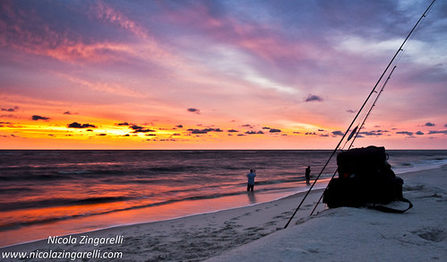 Iguela, Gabon. Surf fishing at sunset by Nicola Zingarelli