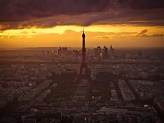 la tour eiffel // paris (pamela ross) Tags: city sunset sky sun paris france clouds pen buildings olympus latoureiffel eiffelturm ep1 tourmontparnasse minolta50mm