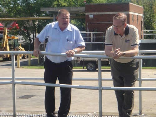 George Myers (left), Milton Regional Sewer Authority Superintendent, explains to Rural Development Under Secretary Dallas Tonsager how the wastewater is currently treated at the existing facility. Construction begins for a state-of-the-art facility this fall that will reduce nitrogen and phosphorus loading to the Chesapeake Bay.