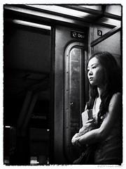 Melancholy.... (CVerwaal) Tags: nyc newyorkcity ladies girls newyork pen subway women olympus mta melancholy emotions subwayportraits olympusep1 mzuiko17mmf28