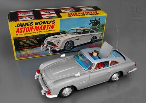JAMES BOND'S ASTON-MARTIN Battery Operated Tin Toy Car with ORIGINAL