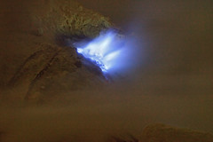 Blue fire on Ijen Crater (Helminadia Ranford(New York)) Tags: travel lake indonesia photography volcano hiking smoke mining crater sulfur helminadia bluefire eastjava kawahijen