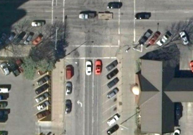 Car Driving in 14th St bike lane, from Google Maps