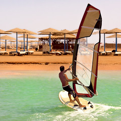 Riding wind, sun and sand (Maine Surfer) Tags: blue red sea vacation sun color beach water canon san egypt sharmelsheikh el arab windsurfing sheikh hurgada sinai shar bedouin yeallow   egypet   mainesurfer