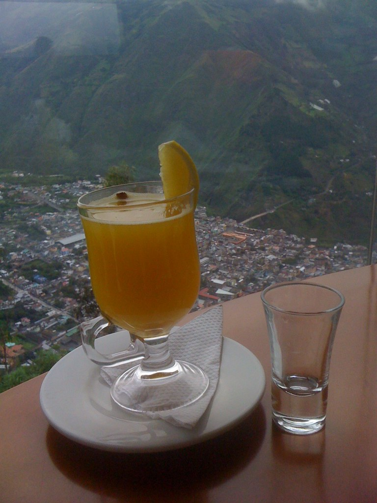 Drinking a Canelazo at Cafe del Cielo with Baños in the Background