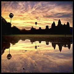 sun rises over the khmer empire.. (PNike (Prashanth Naik..back after ages)) Tags: sky panorama orange reflection building water vertical architecture clouds sunrise temple lights interestingness interesting ancient nikon ruins asia cambodia khmer prayer religion kingdom angkorwat empire siem reap angkor wat vertorama d7000 pnike yahoo:yourpictures=reflecti