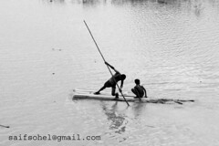 against the current (saifsohel) Tags: boy water boat flood bangladesh treeboat playwithwater bbaria kosba koikhola