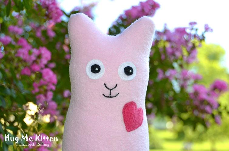 Pink fleece Hug Me Kitten by Elizabeth Ruffing, with pink crape myrtle